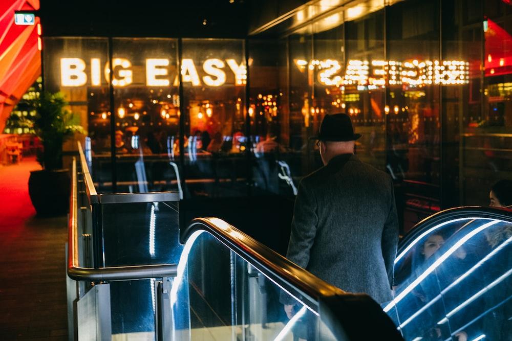 man going down to escalator