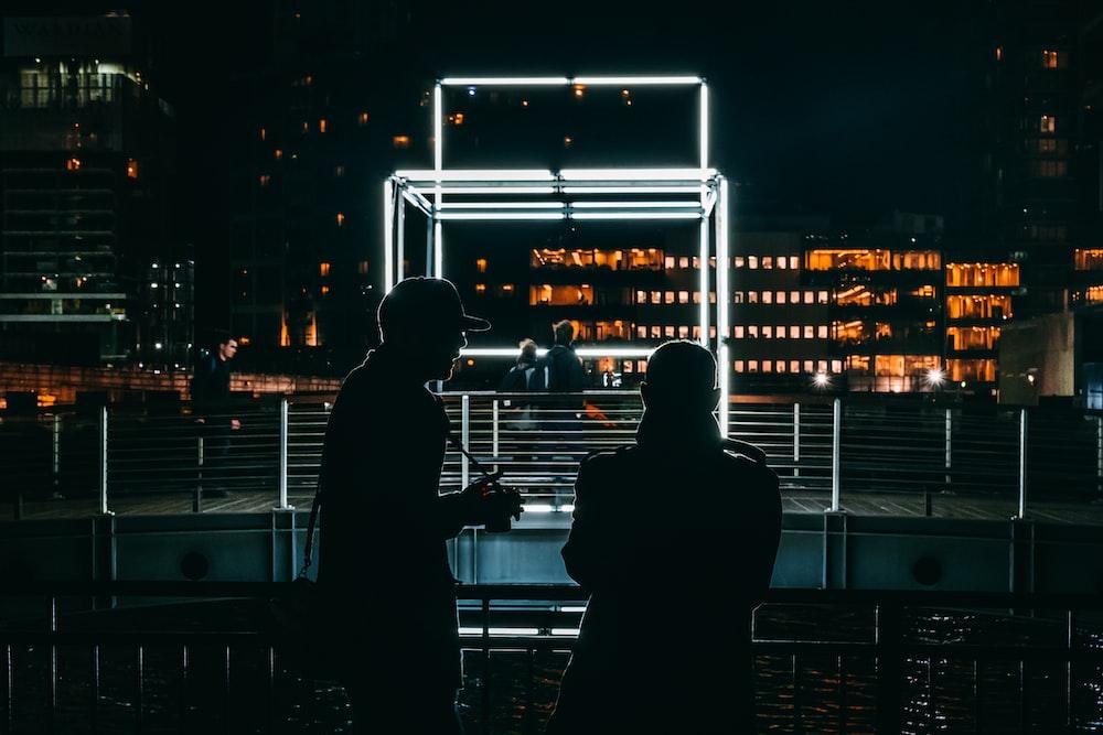wo men talking in front of LED light frame