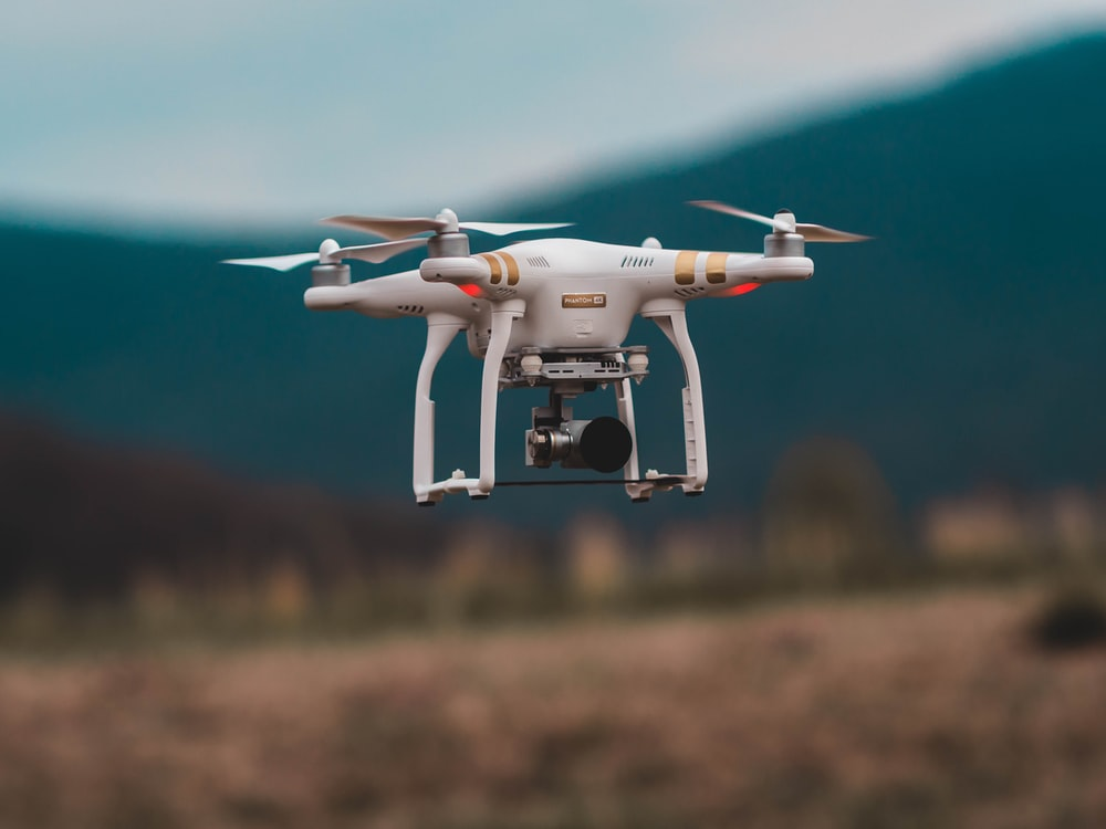 selective focus photography of DJI Phantom 3 Professional quadcopter drone