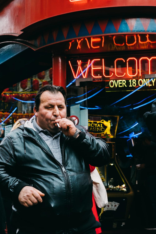 man smoking street