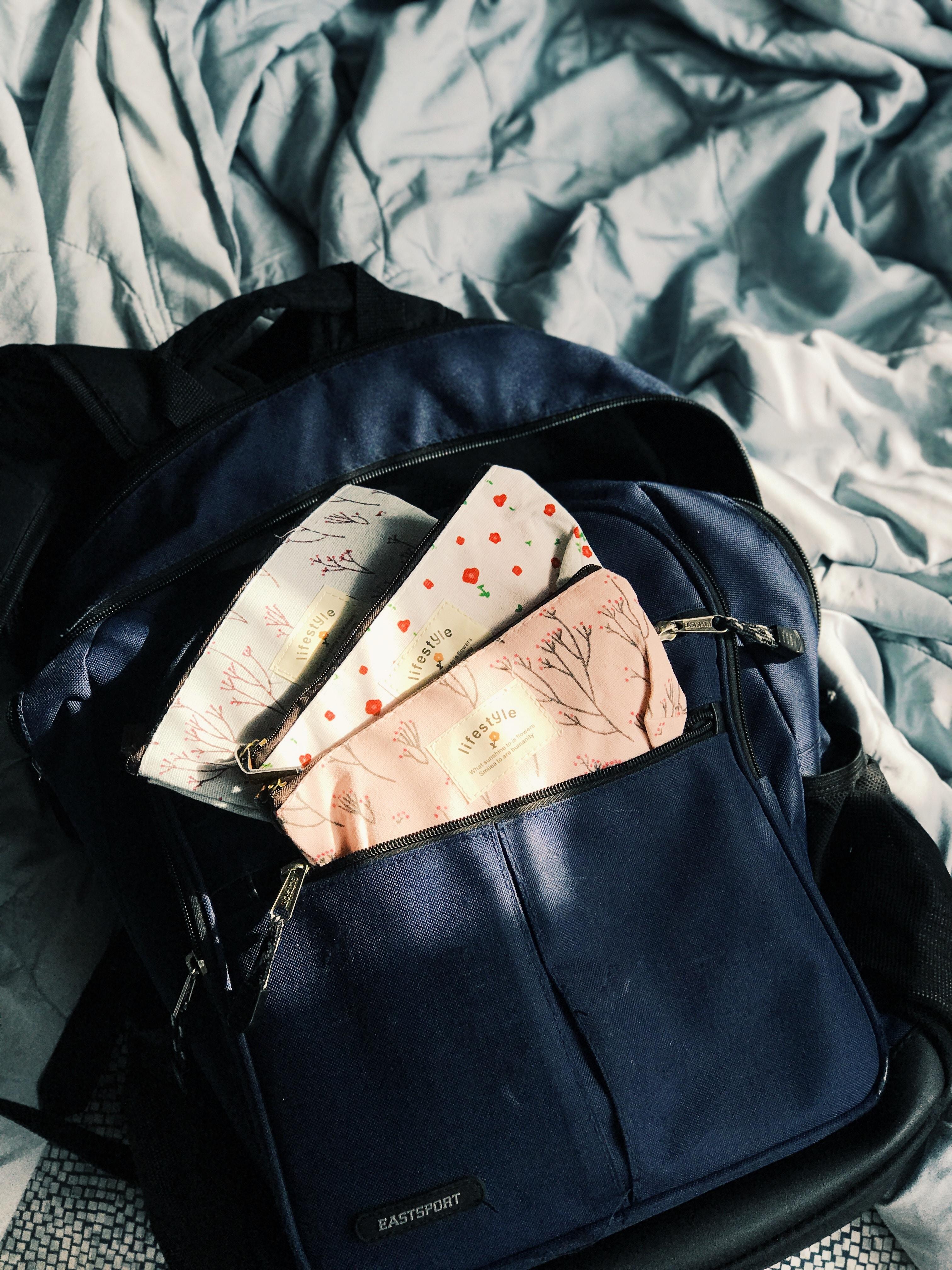 three white plastic packs in black leather bag