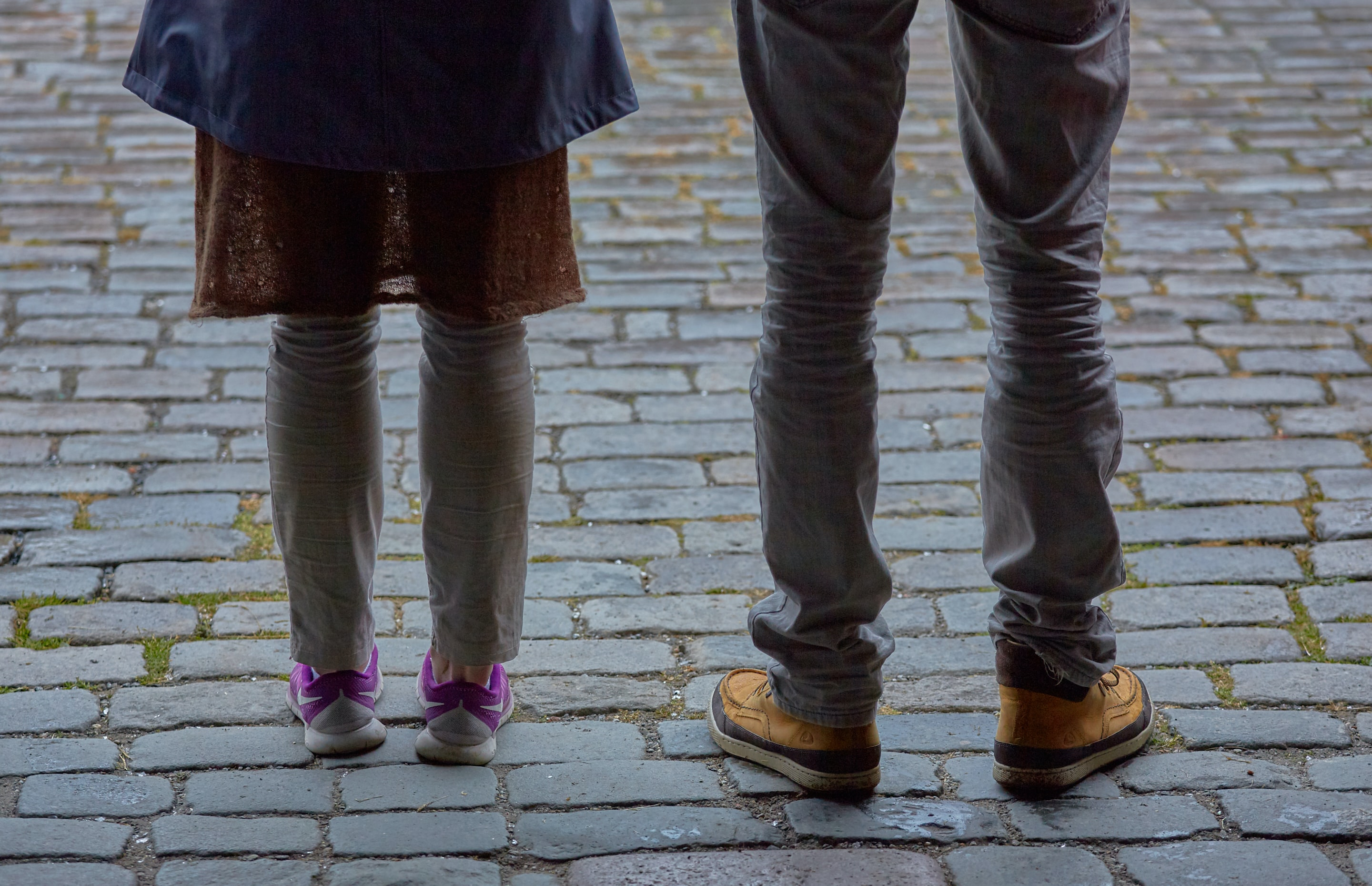 two person standing pavement