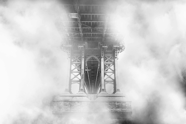 black truss bridge covered with fog digital wallpaper