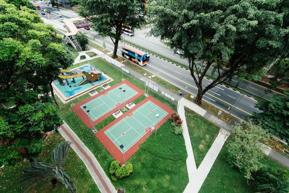 bird's eye view photo of two empty tennis fields
