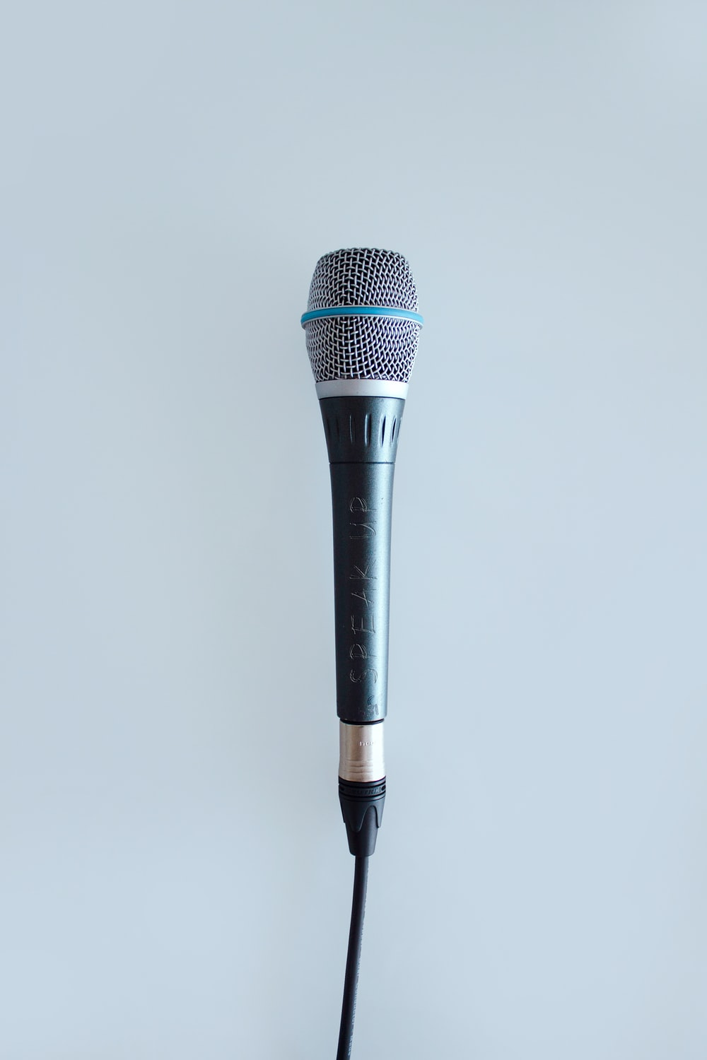 black and gray corded microphone