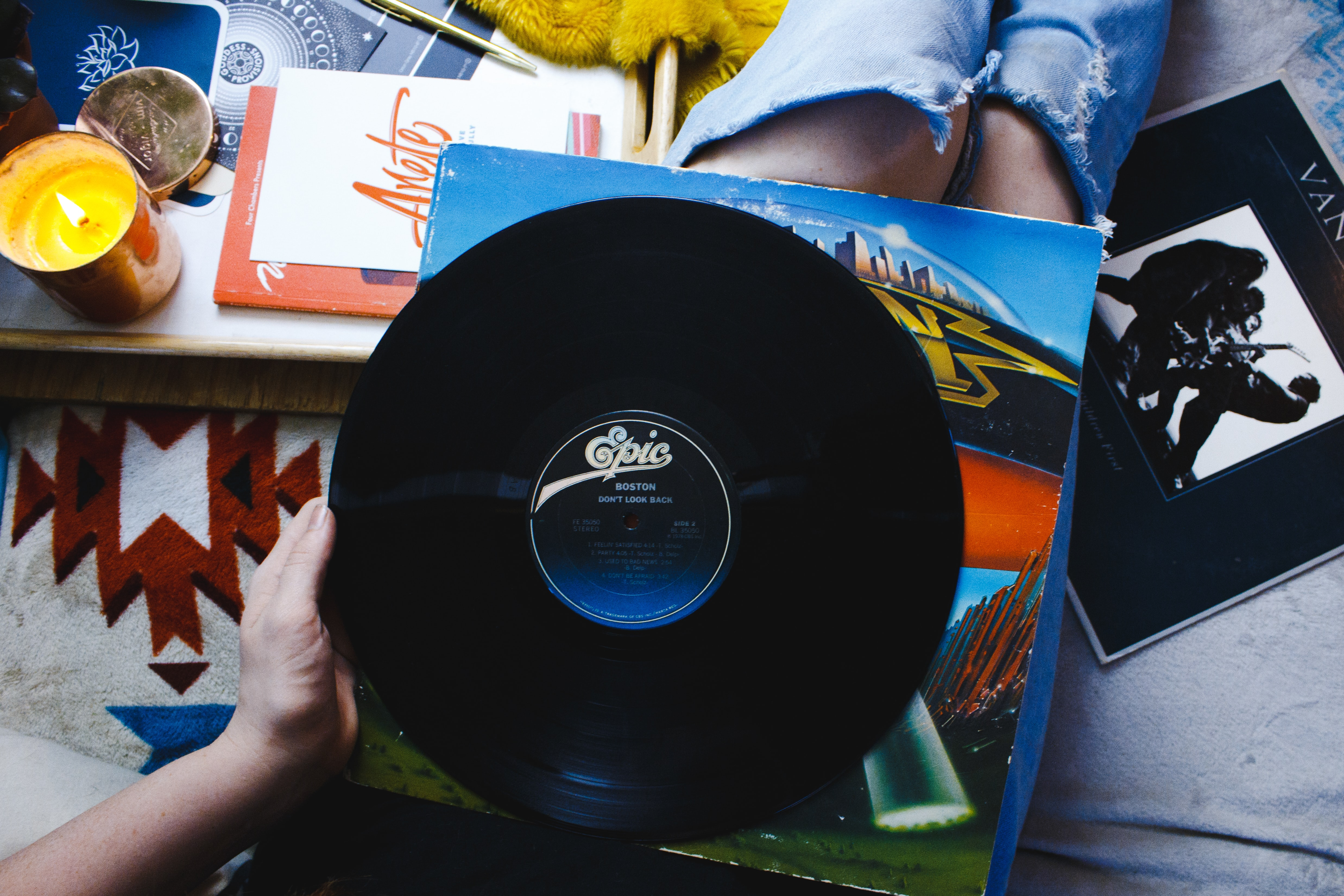 person holding Epic vinyl record