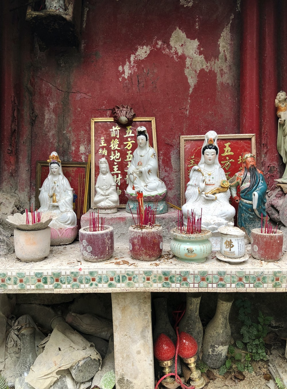 five assorted ceramic Hindu god figurines