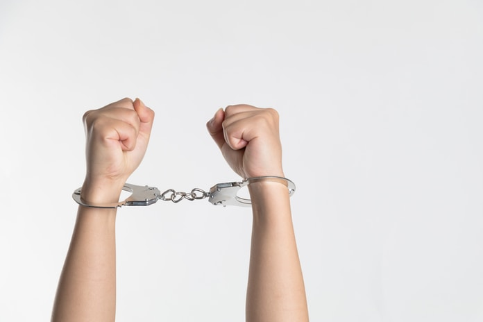 person showing handcuff