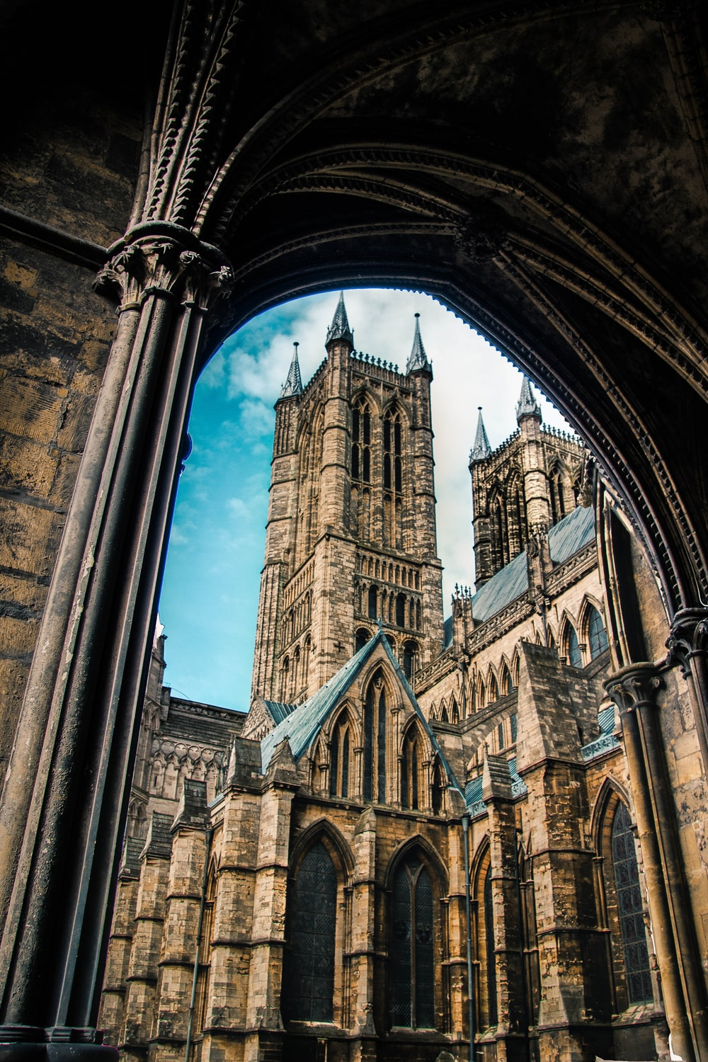 low-angle photography of brown gothic cathedral
