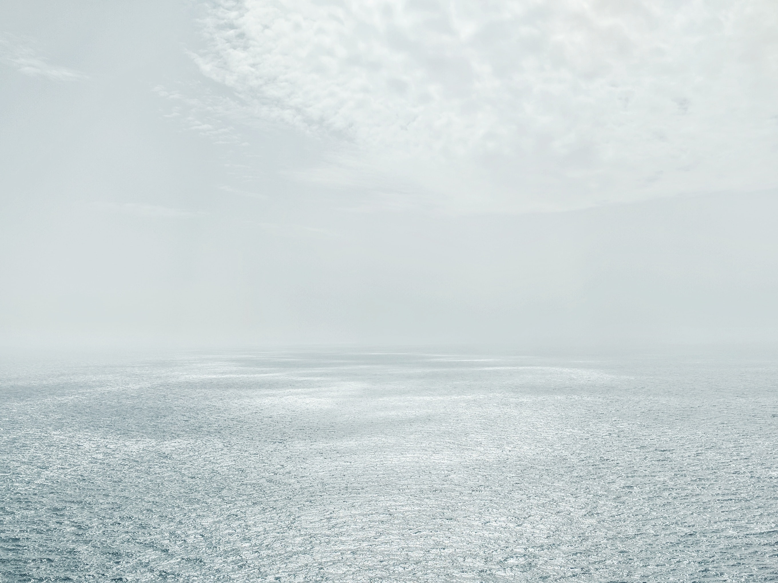photo of empty ocean during day time