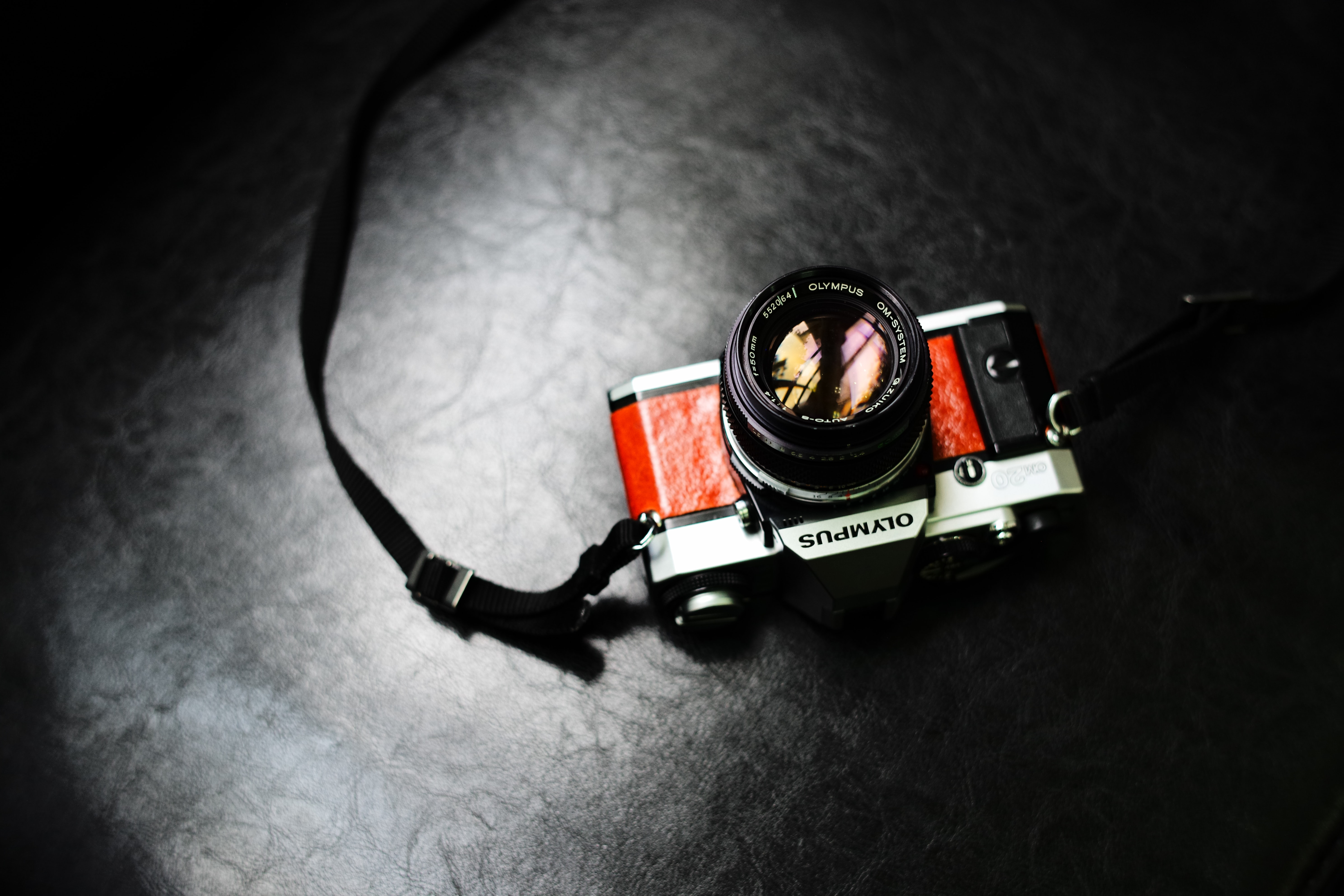 photography of gray and red disposable camera