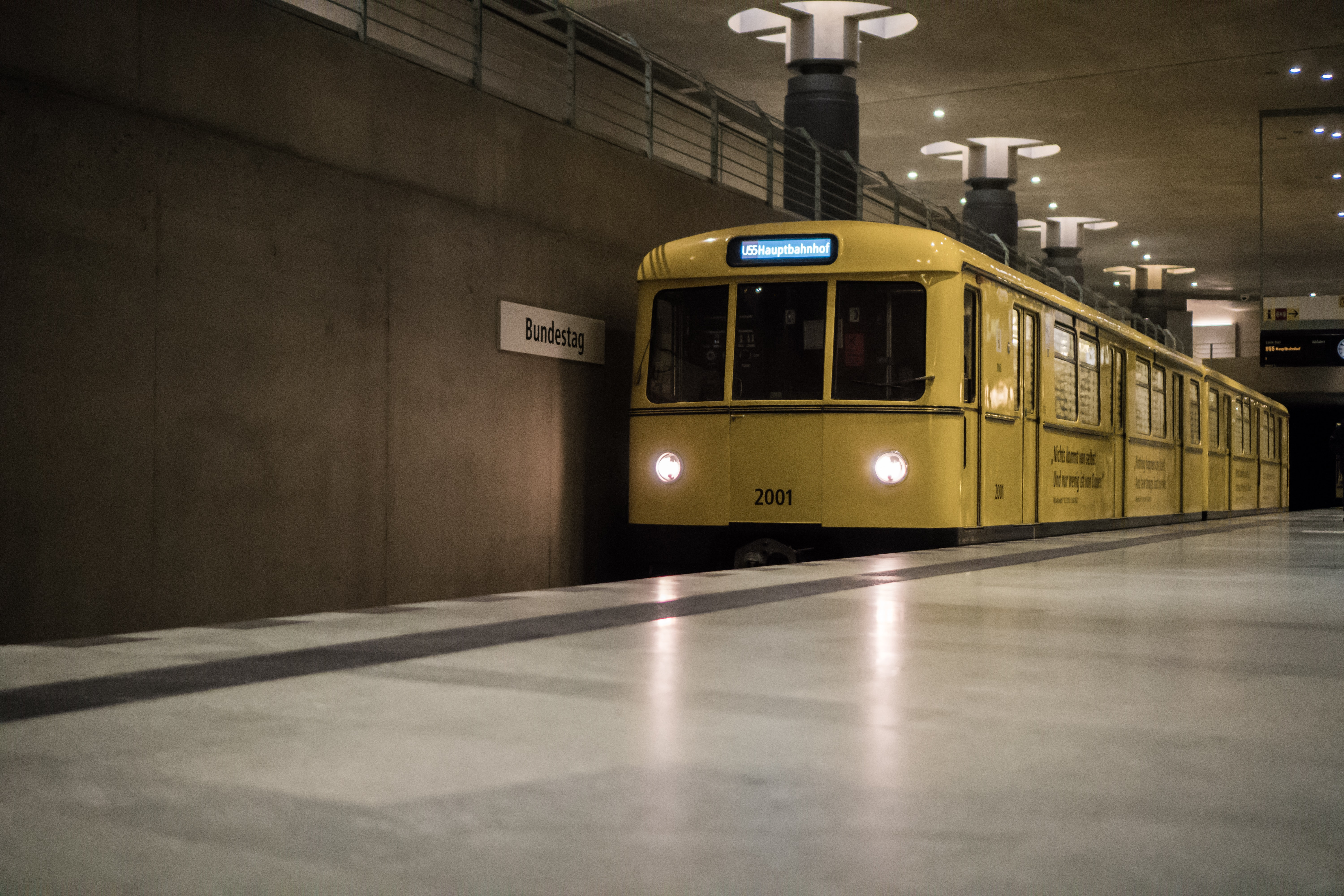 yellow electric train in station
