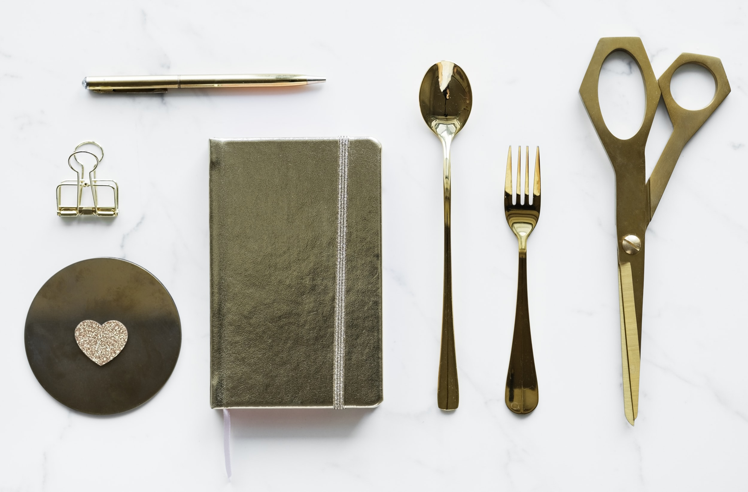 spoon and fork on top of desk