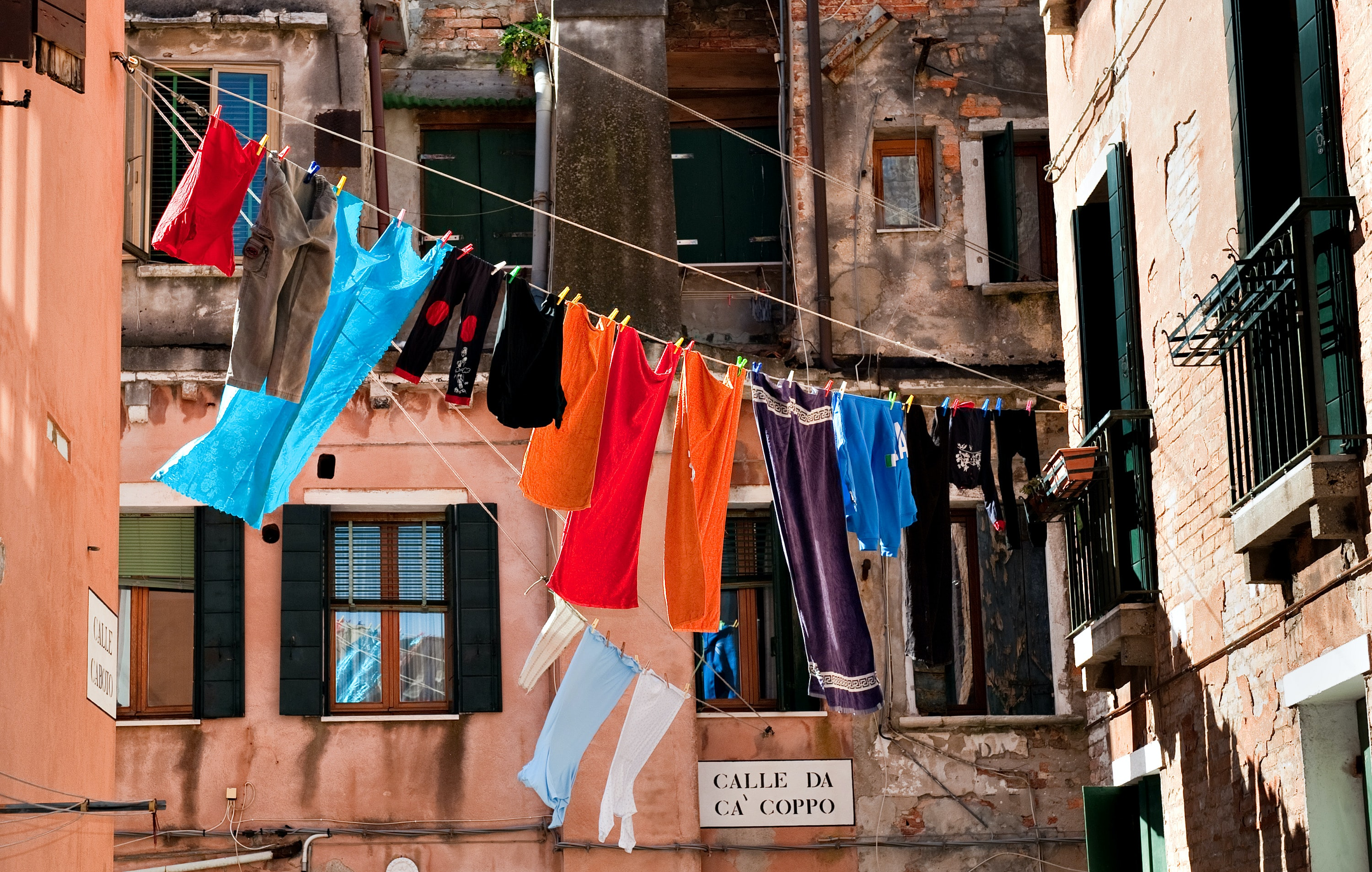 hang assorted-color clothes at daytime