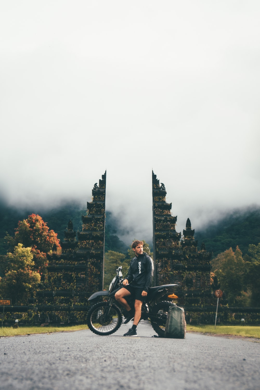 man sitting on dirtbike