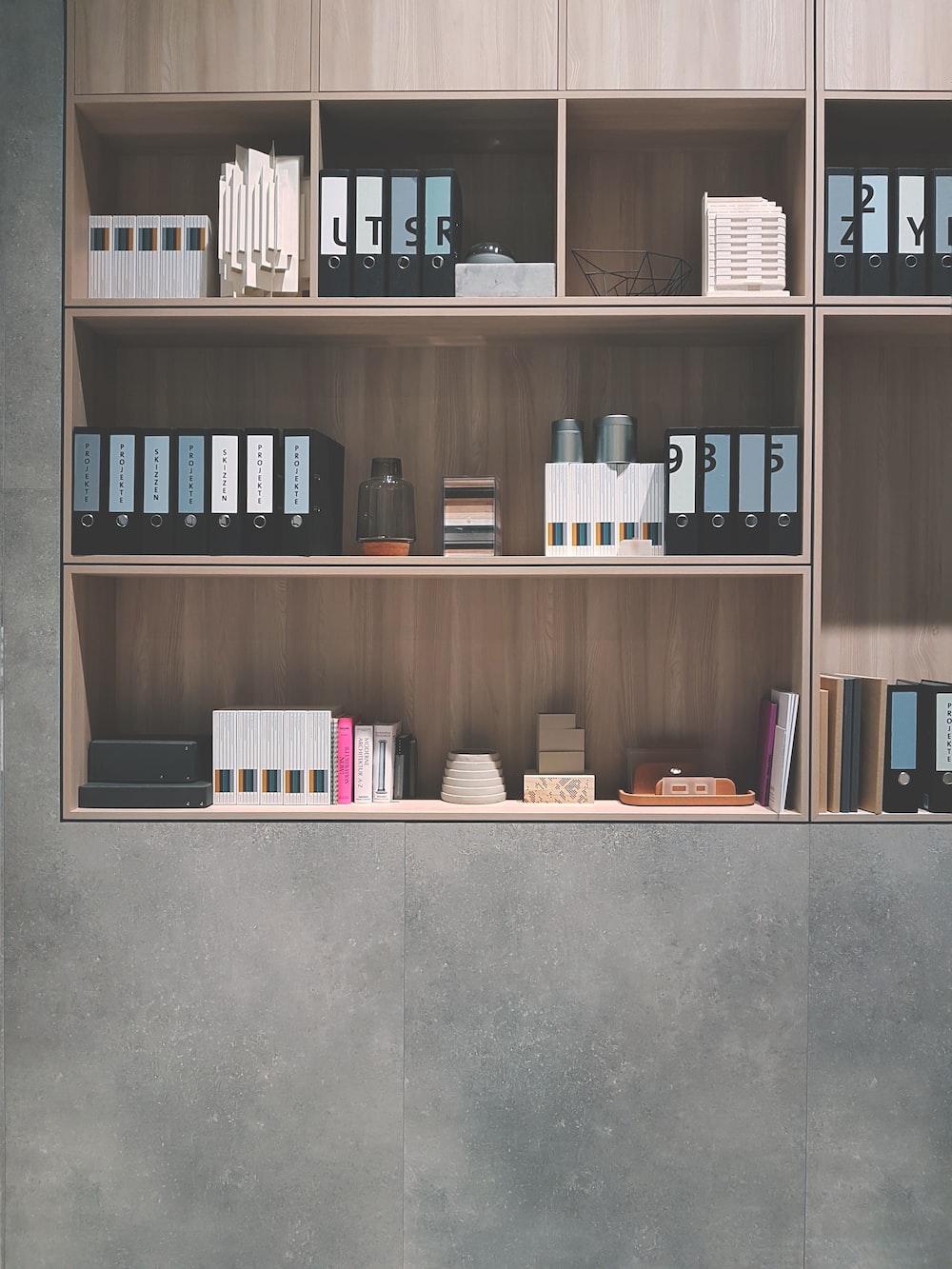 brown wooden shelf on grey wall