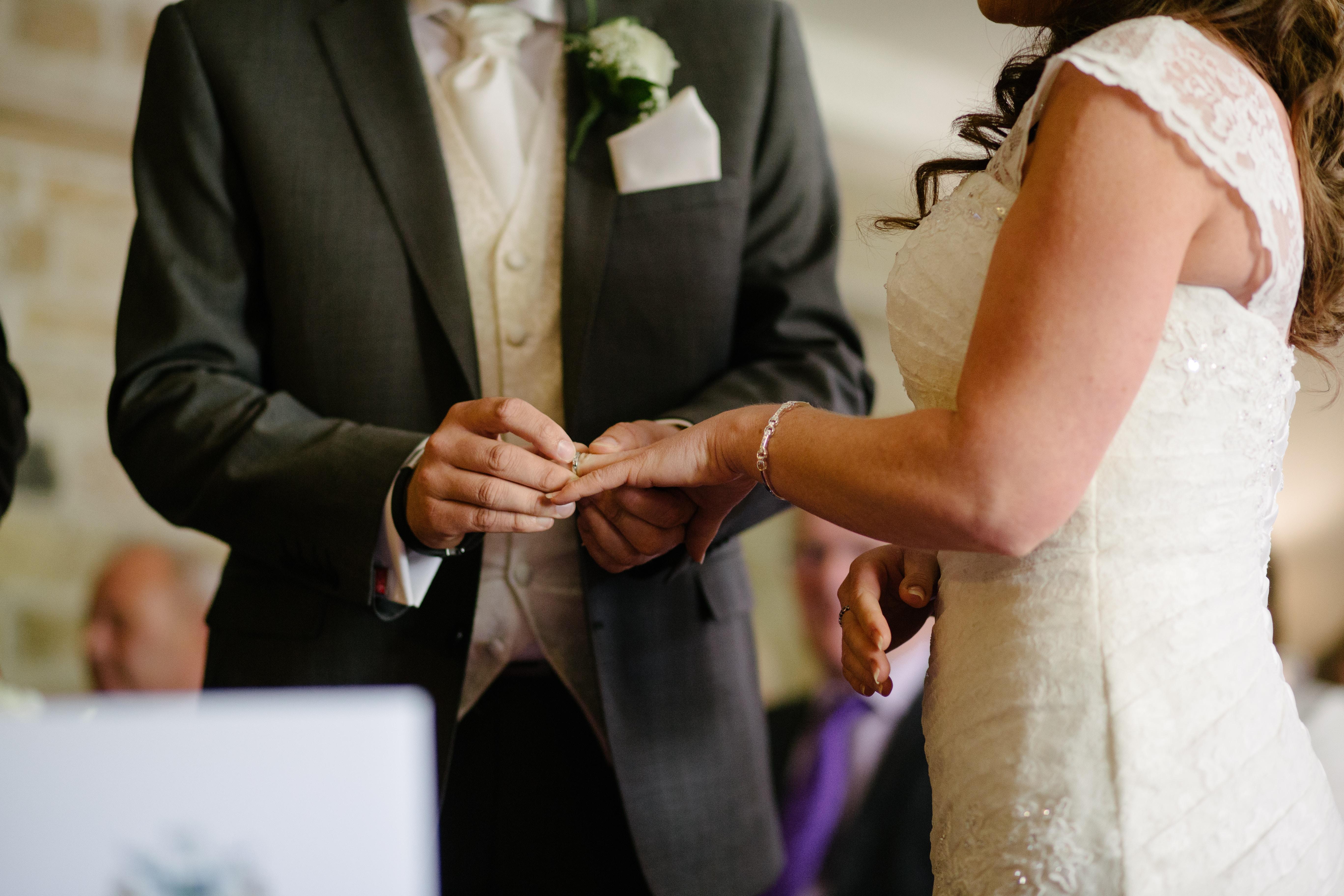 groom holding wedding