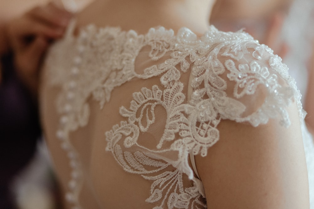 woman wearing white sheer lace wedding gown