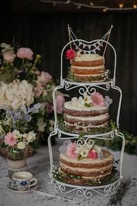 three cakes on white wire cake rack