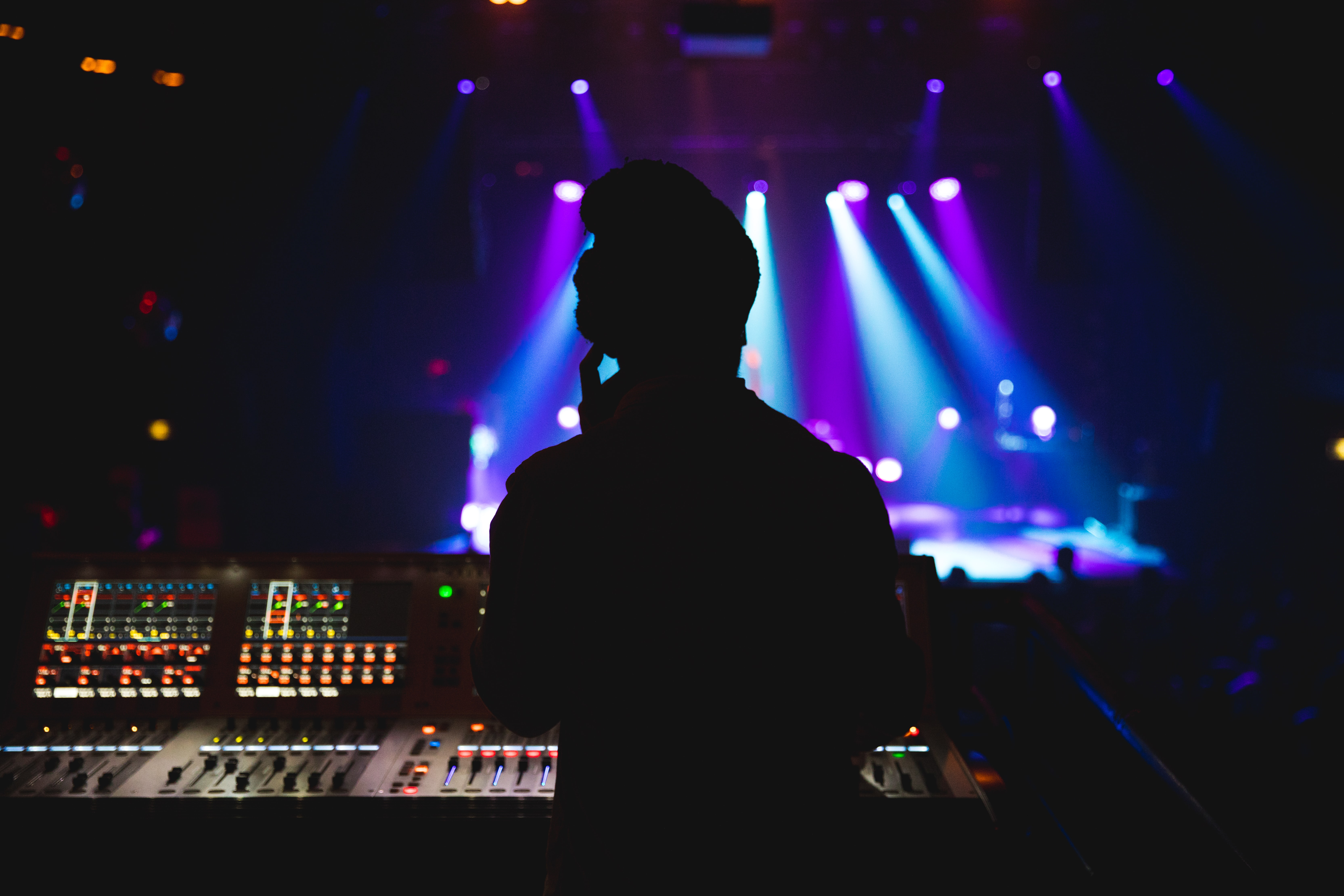 silhouette photography of DJ mixing a music