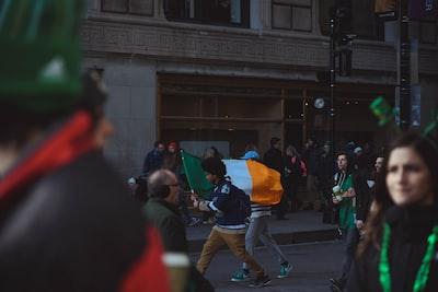 people walking with indian flag shamrock zoom background