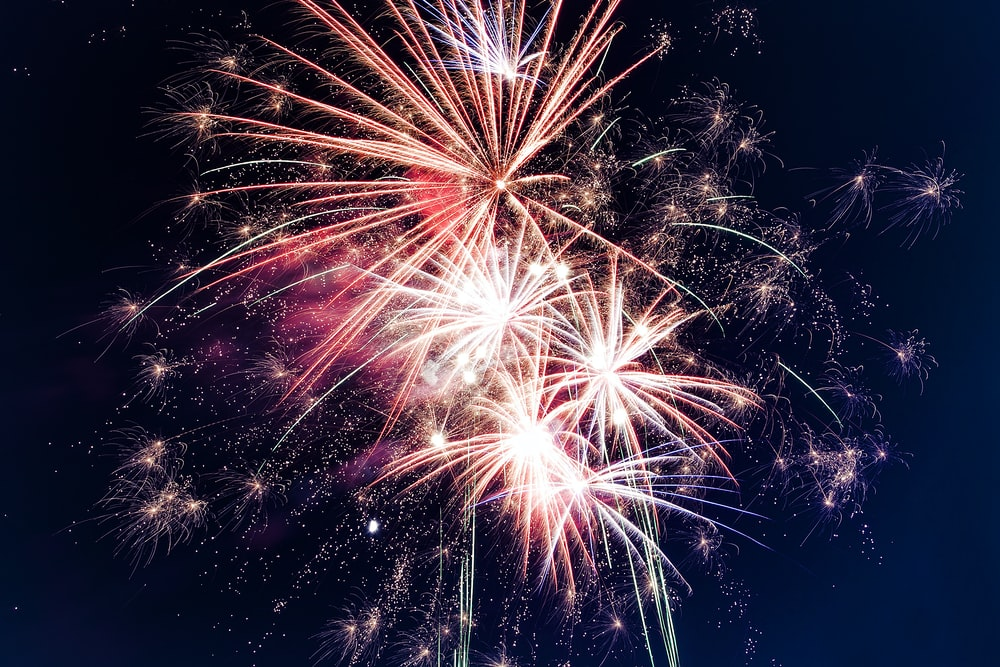 time lapse photography of fireworks at night