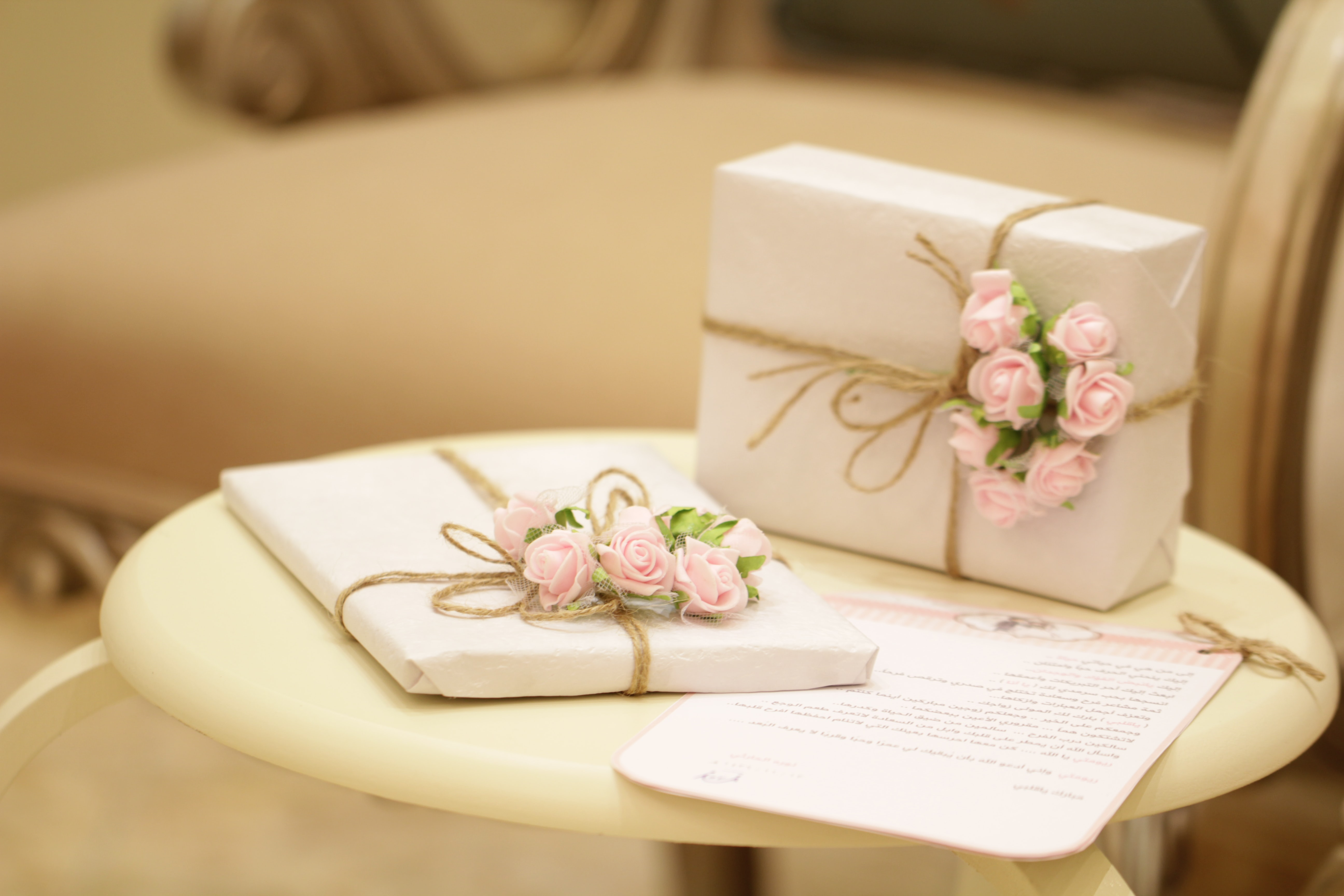 two pink and white floral boxes