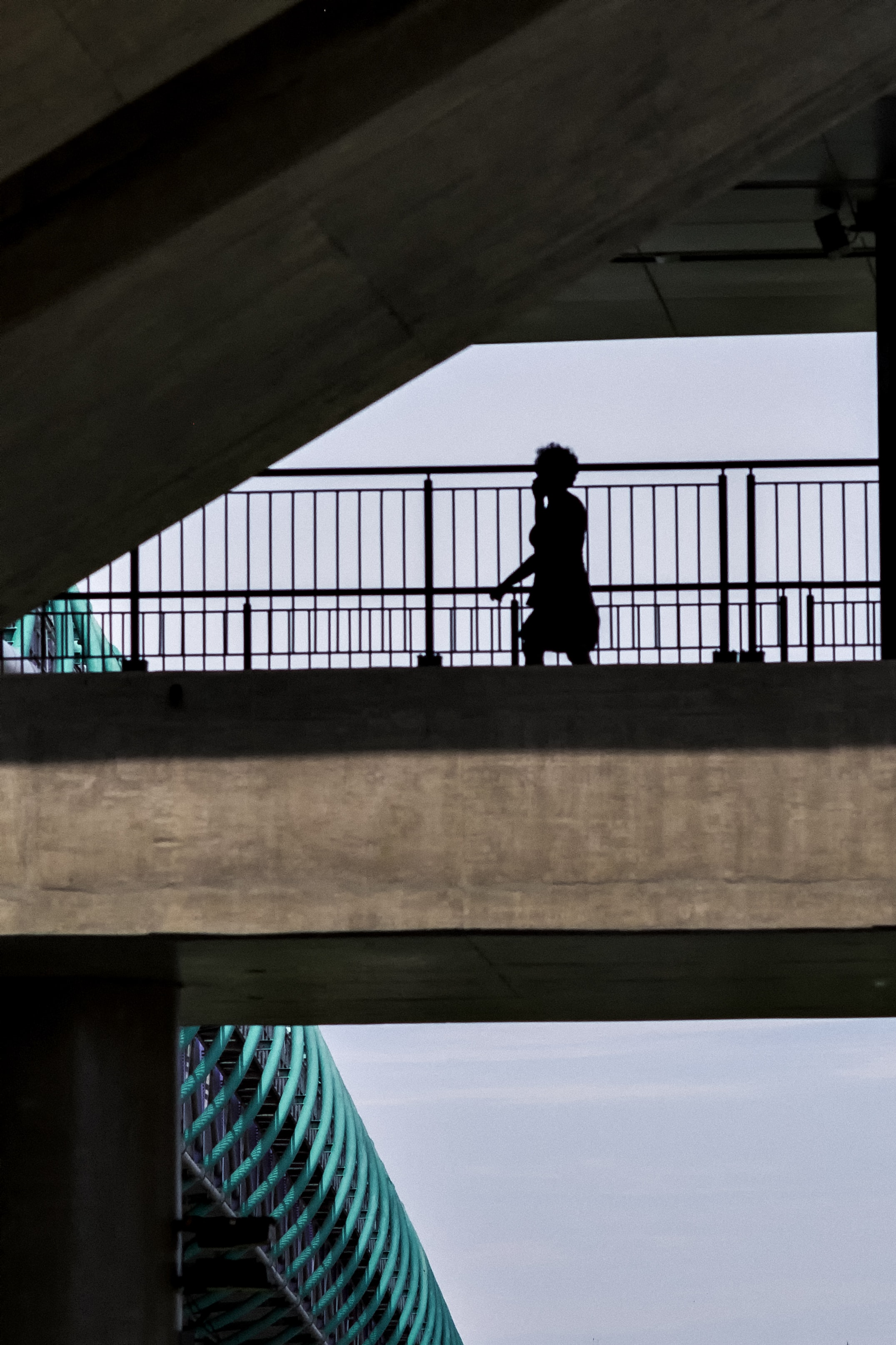 low angle of person crossing overpass