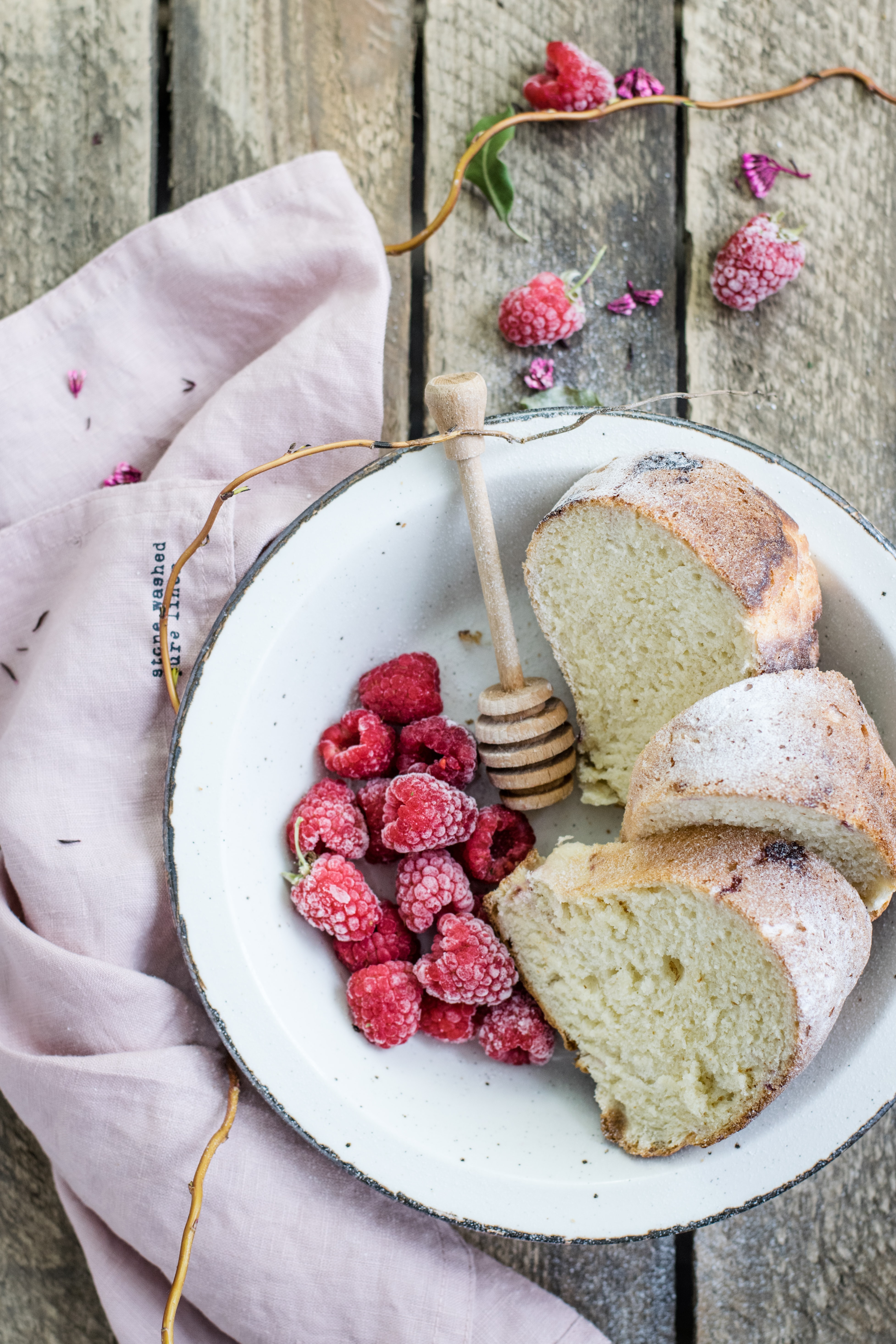 toasted bread and raspberry served on white plate
