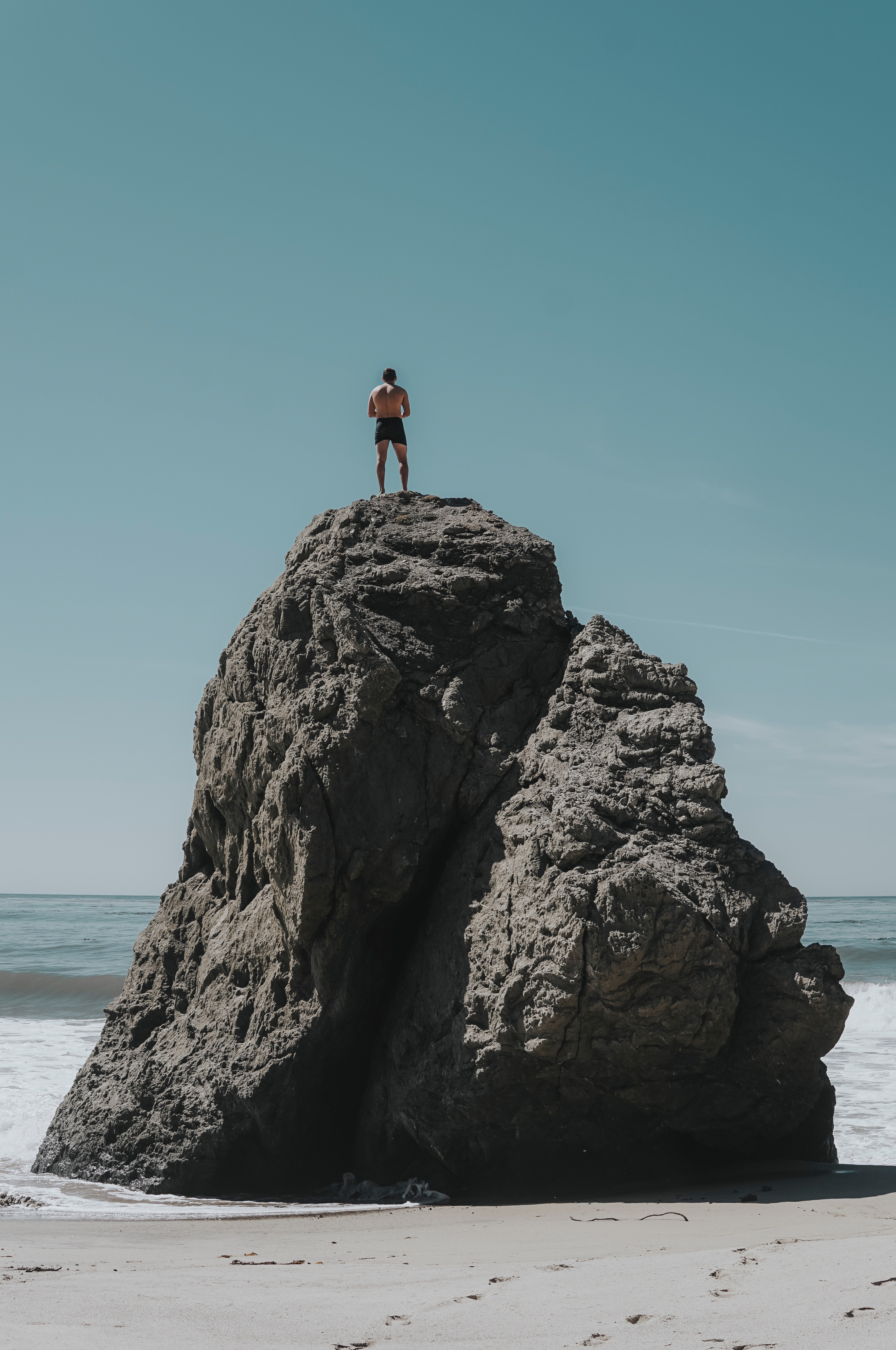 person standing at rock formation