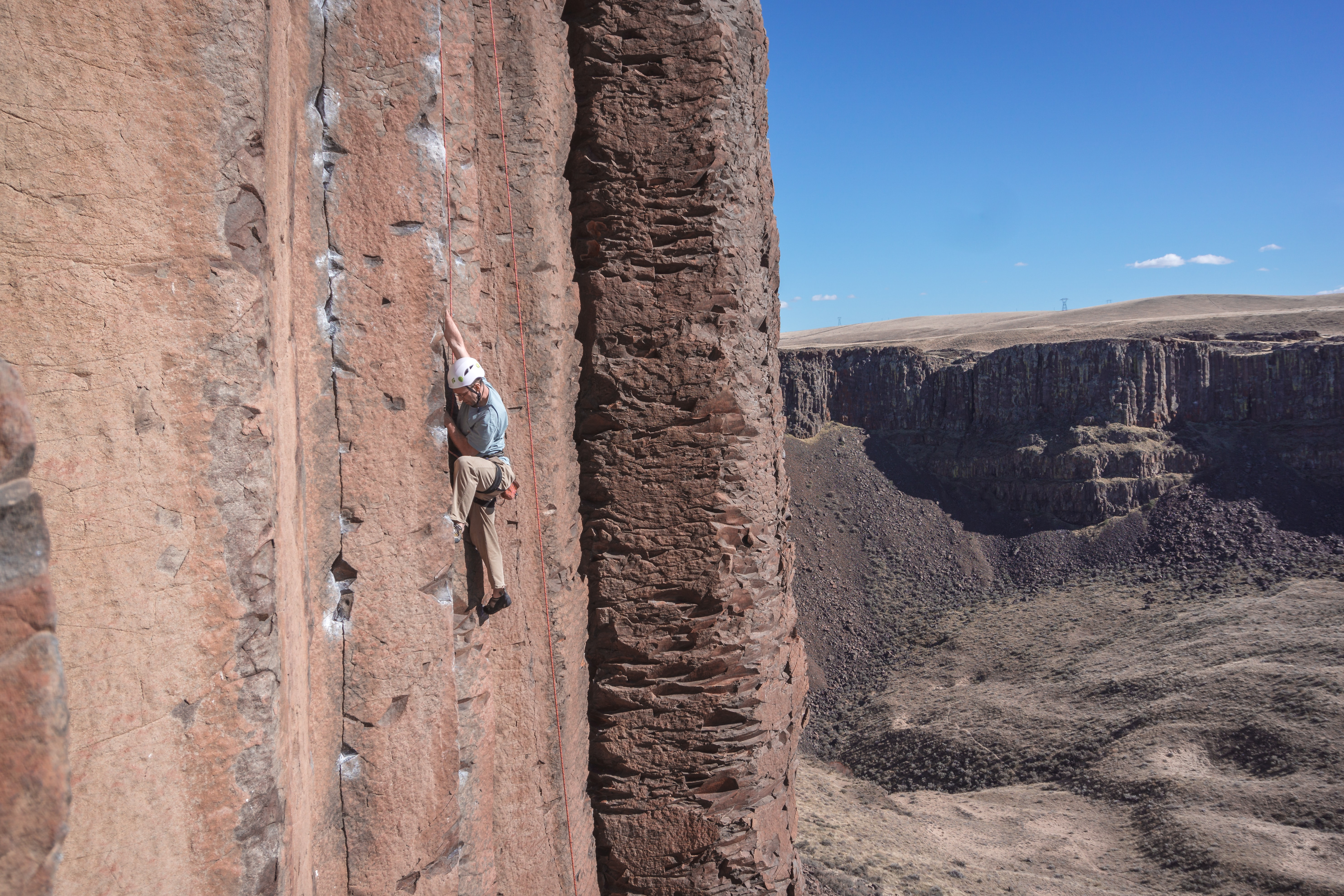 man mountain climbing during daytime