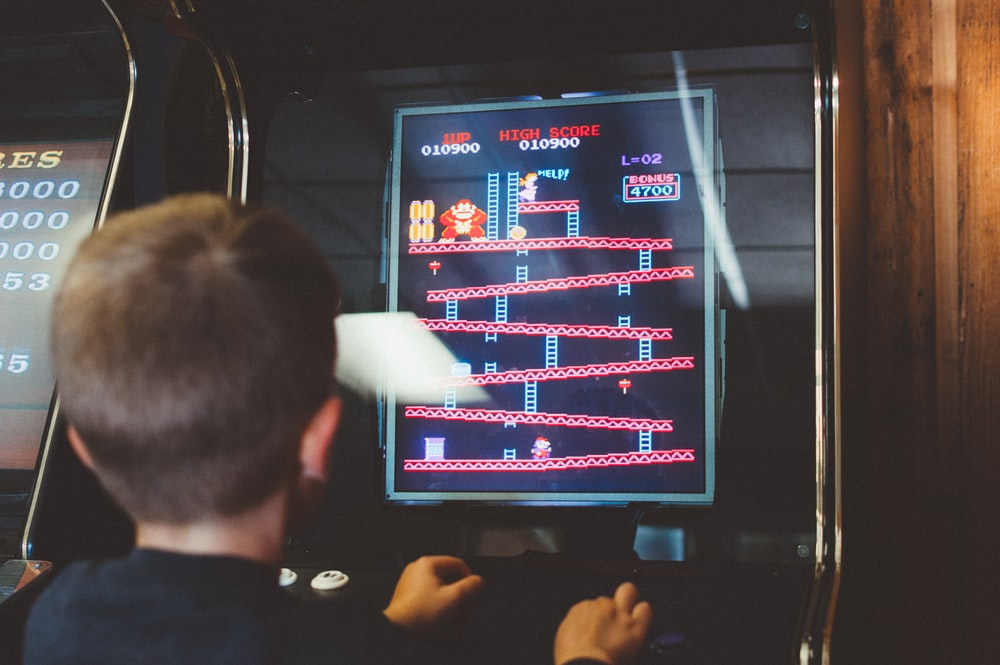 boy playing donkey kong arcade box