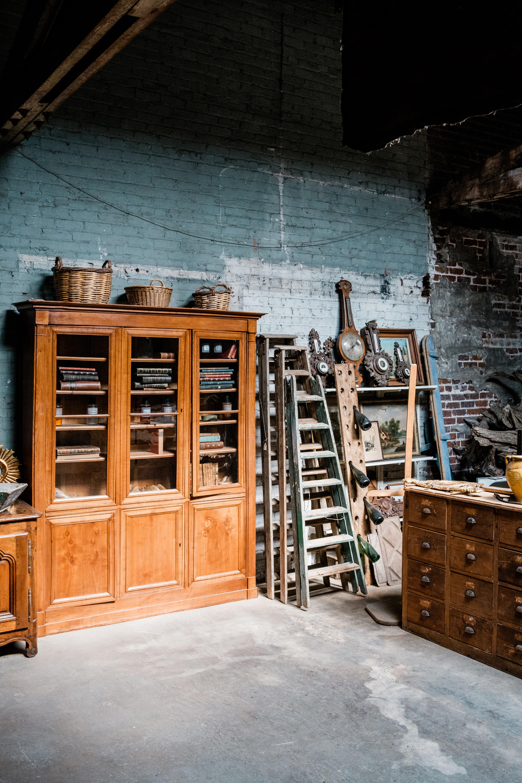 brown wooden breakfront cabinet
