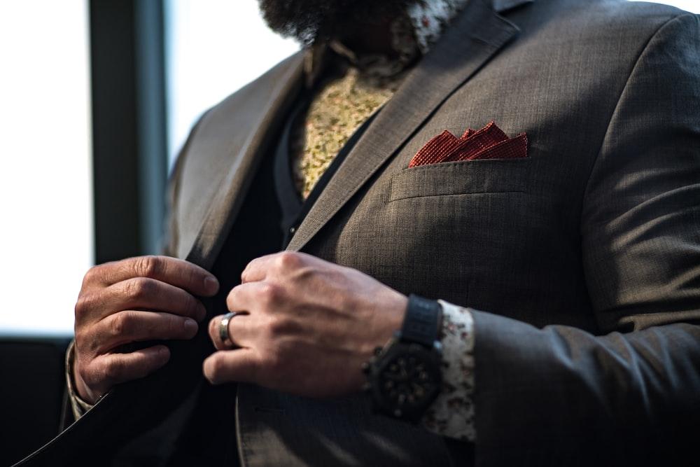 man wearing grey notched-lapel suit jacket