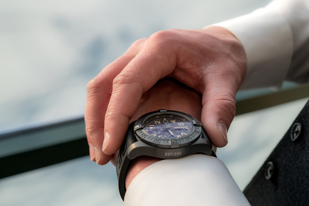person looking at watch