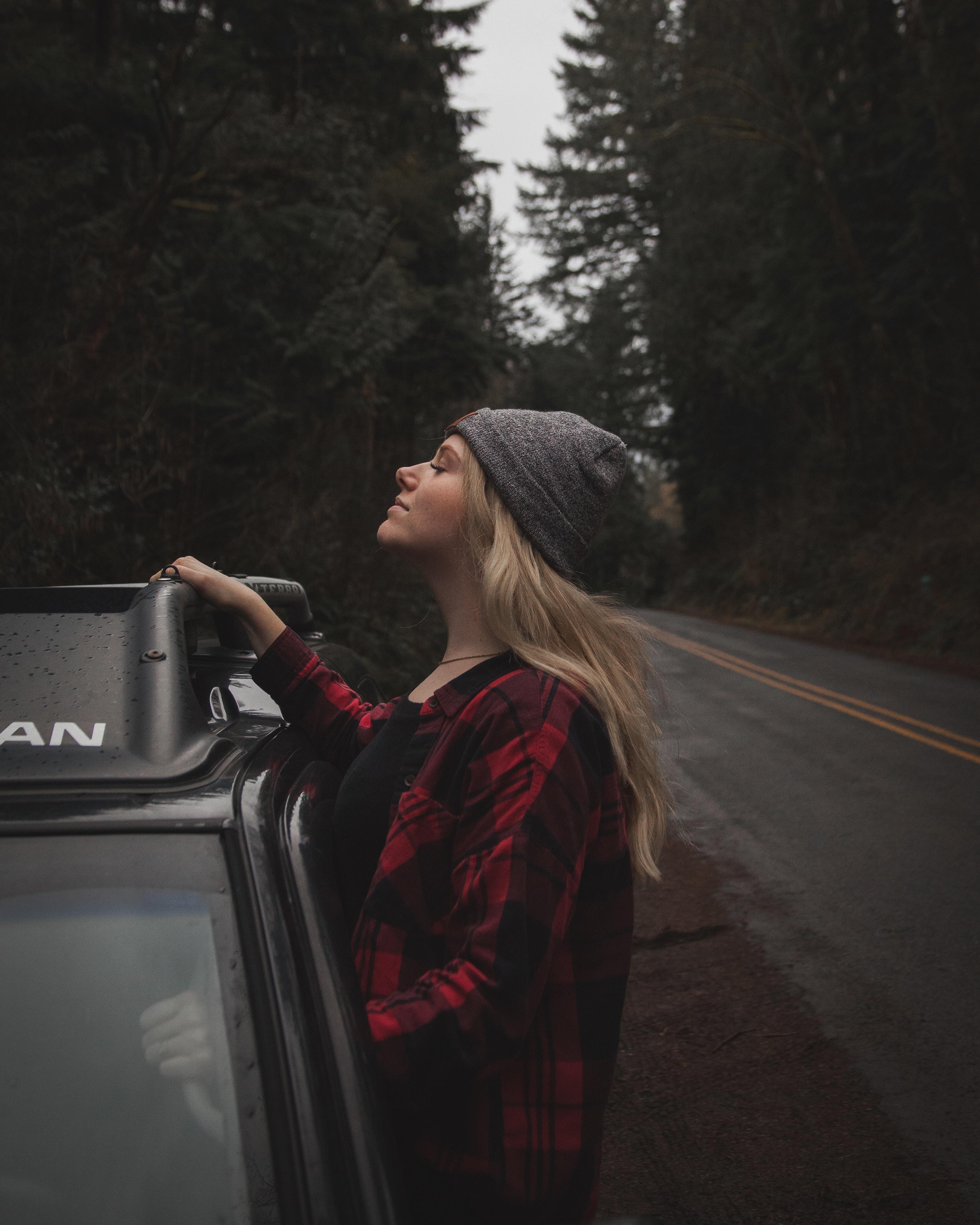 woman peeking outside vehicle
