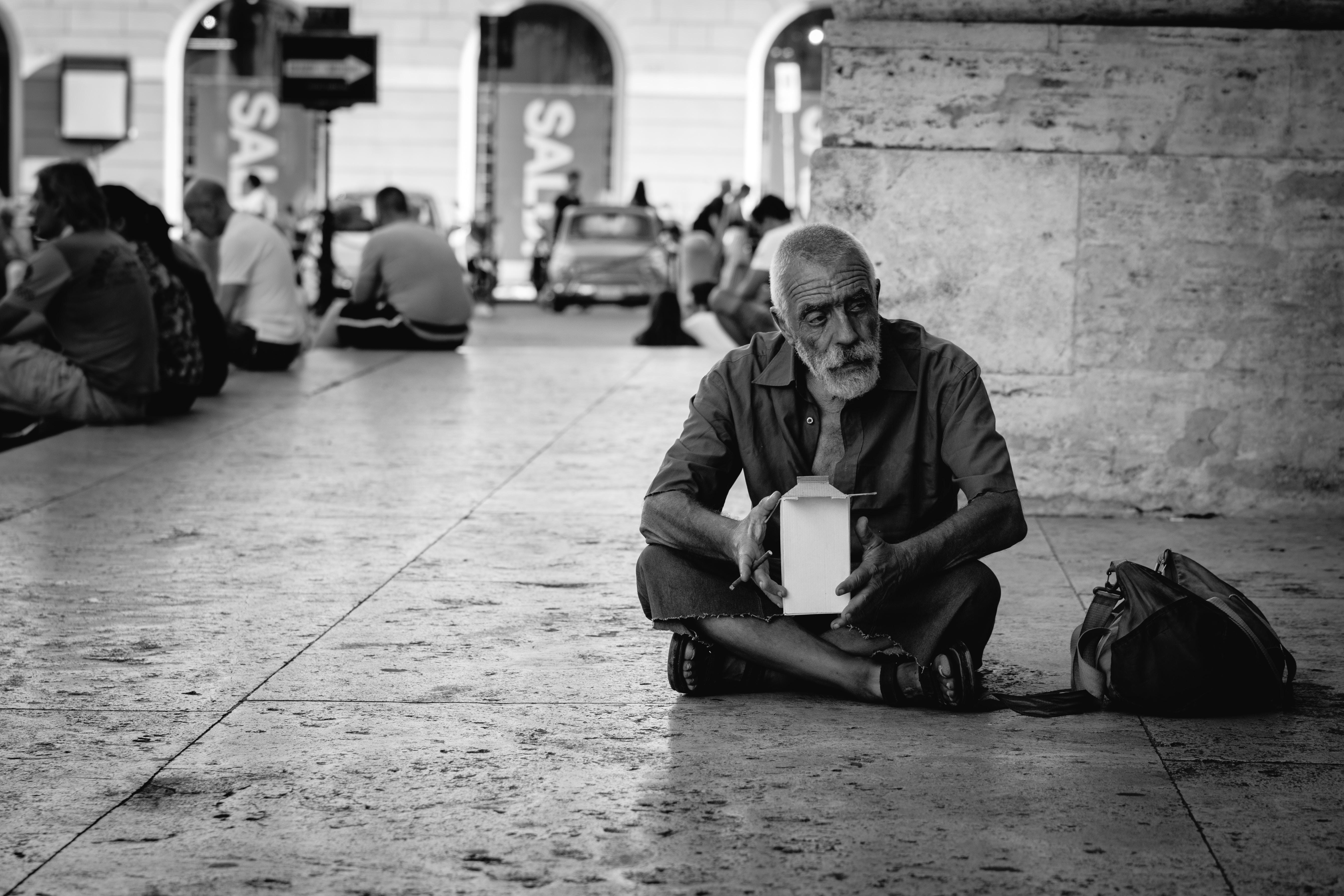 man sitting on tiles