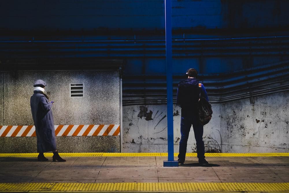 man standing near post