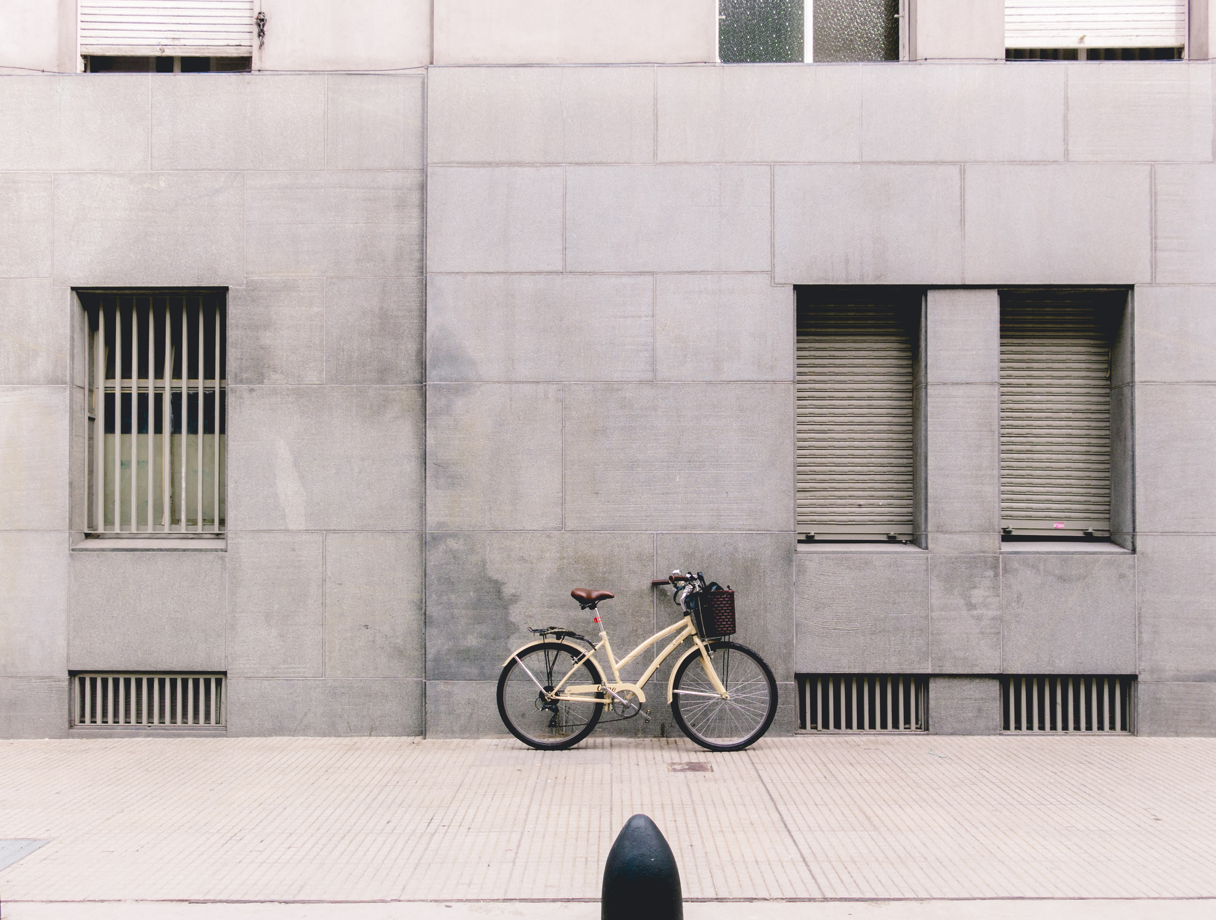person taking photo of white parked bicycle