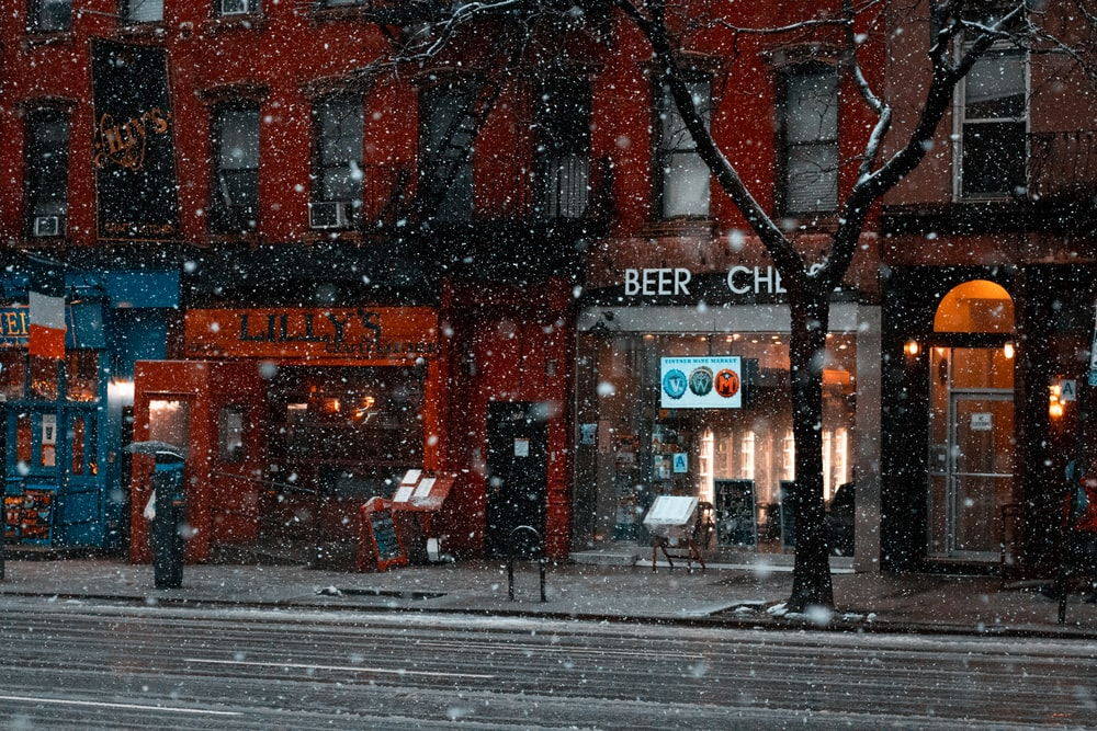 view of stores while snowing