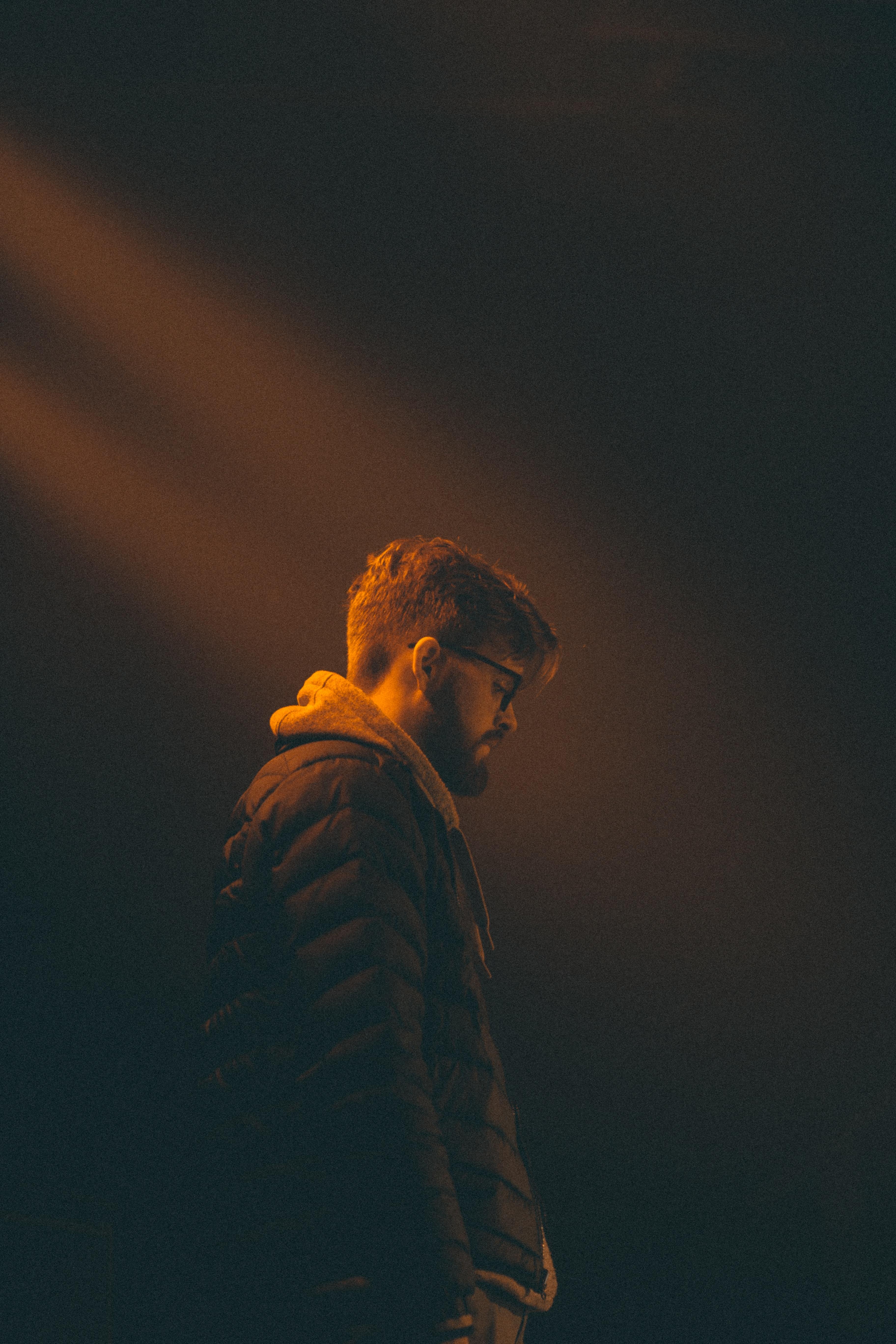 man standing in dark room