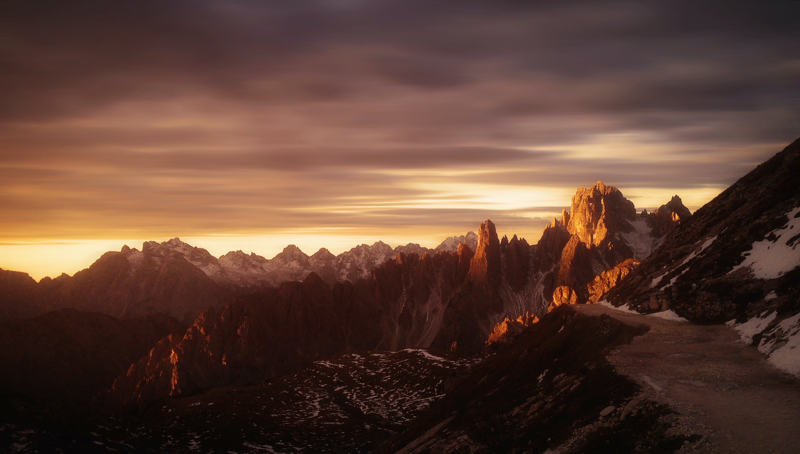landscape photo of mountain range during golden hour
