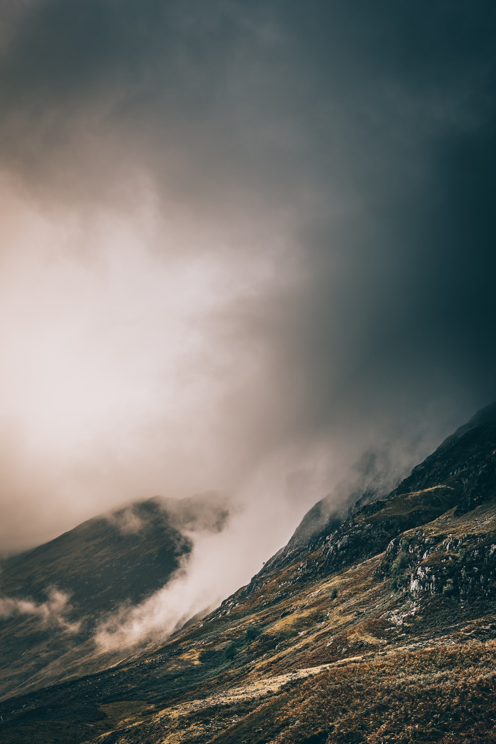 landscape photo of mountain covered with fog