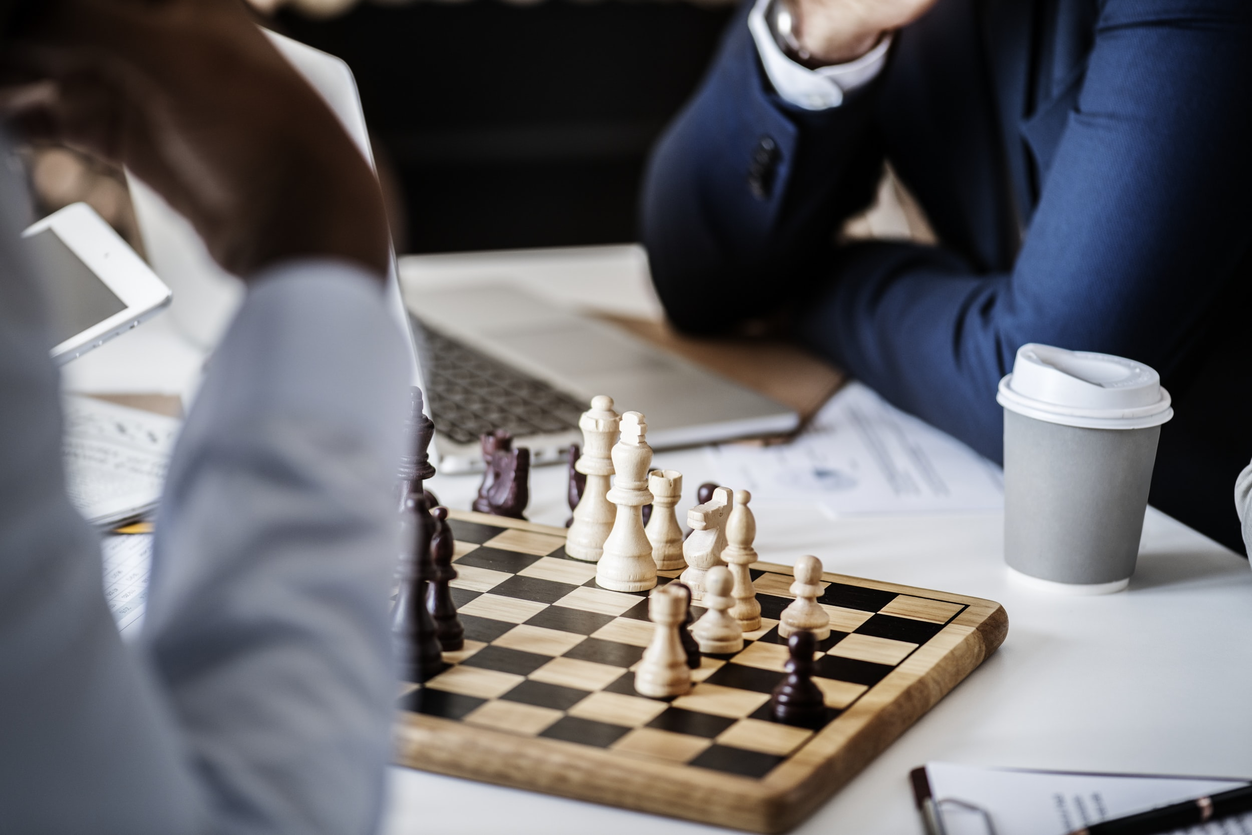 photo of two person playing chess board