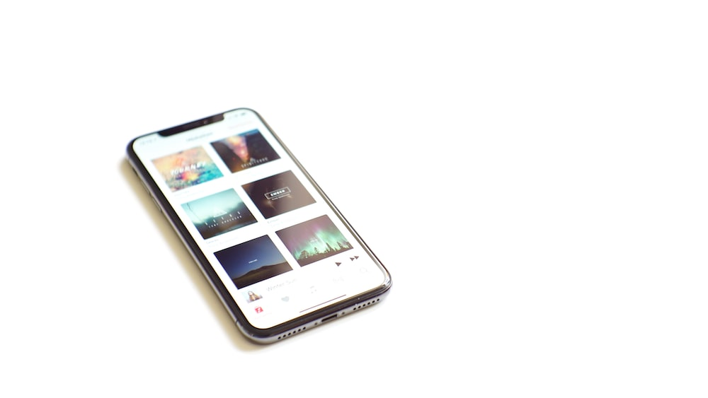 space gray iPhone X on white surface