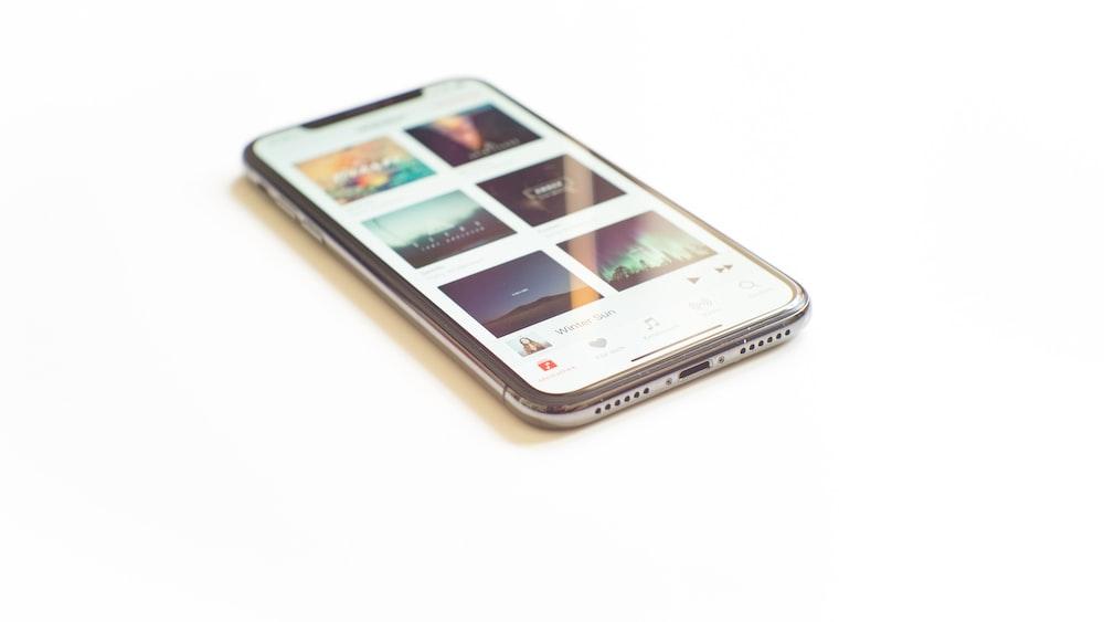 silver iPhone X on Apple Music menu
