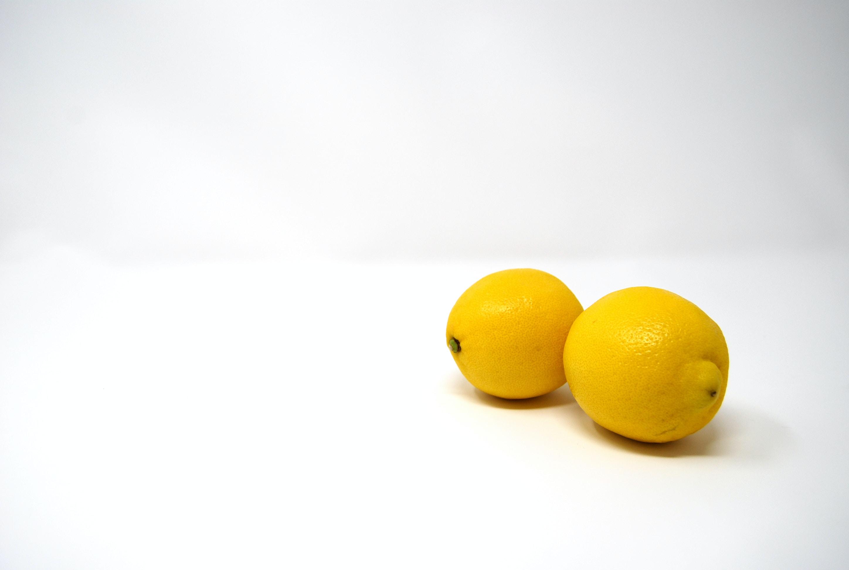 two yellow lemons