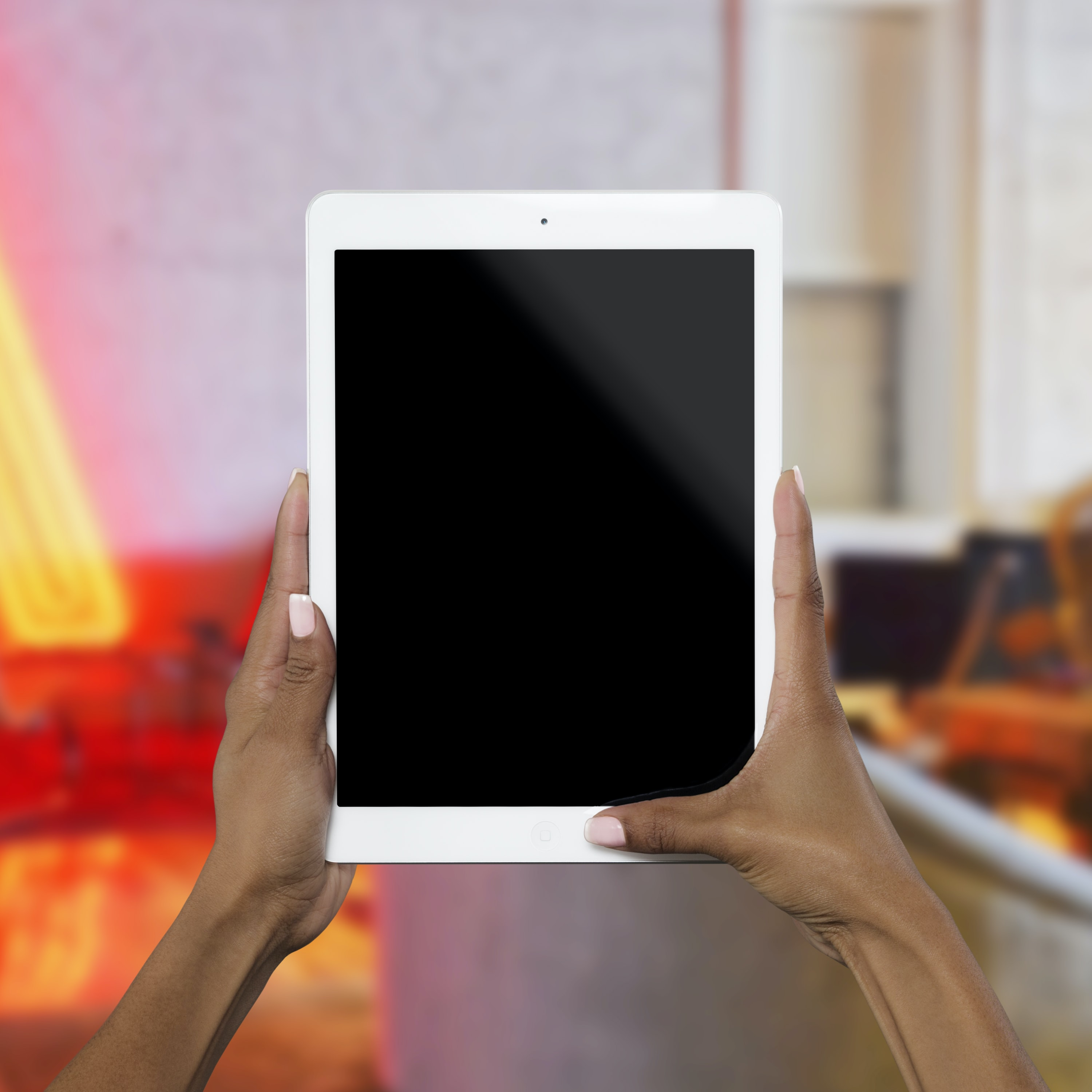person holding white iPad