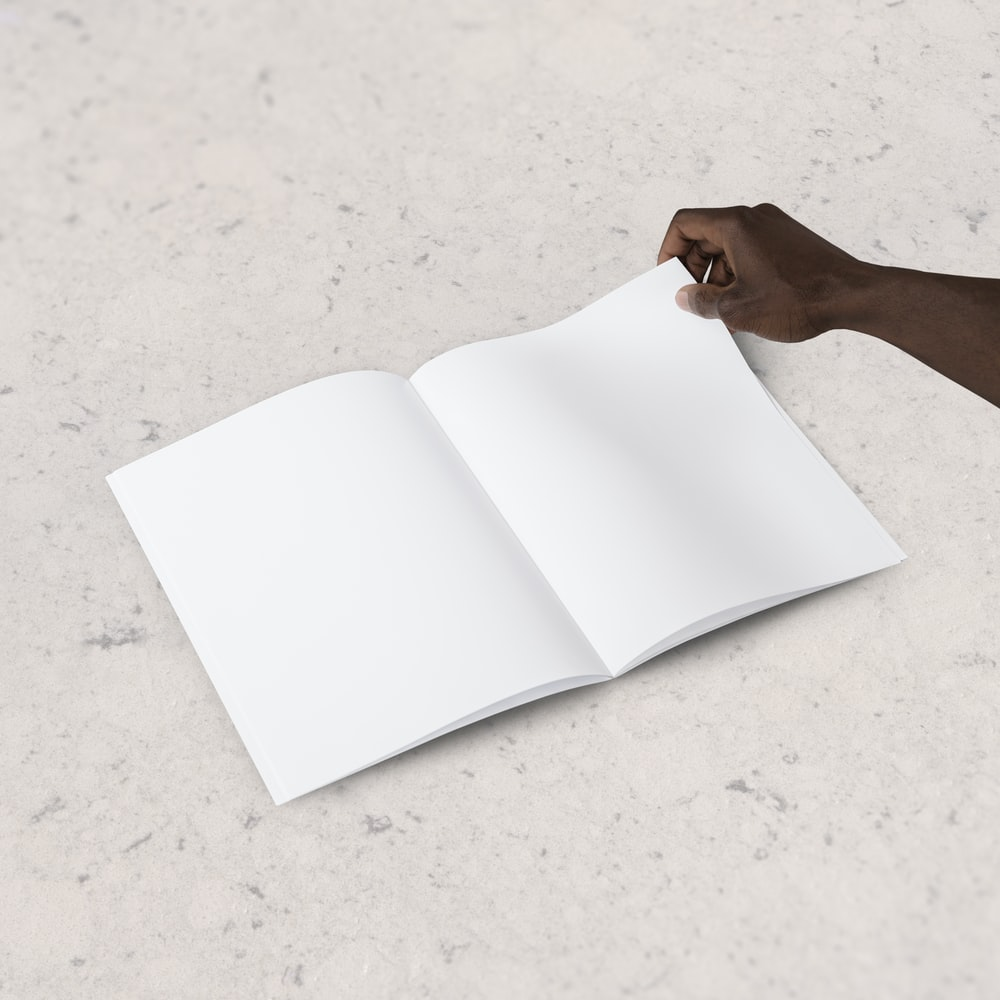 person holding blank book page