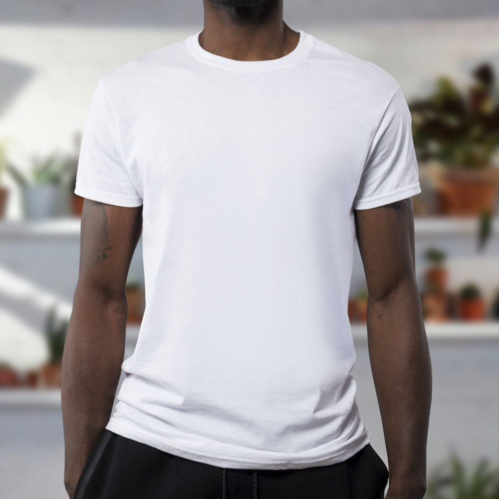 man wearing white crew-neck t-shirts